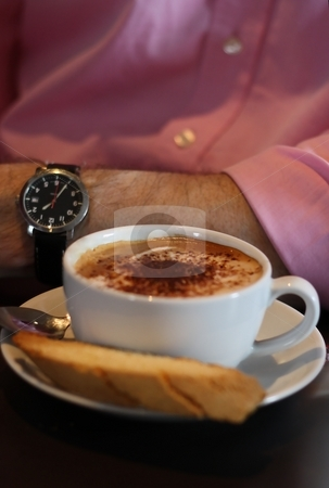 Coffee Time stock photo, Cup of cappuccino/coffee with man in pink business shirt and watch by Keri Bevan