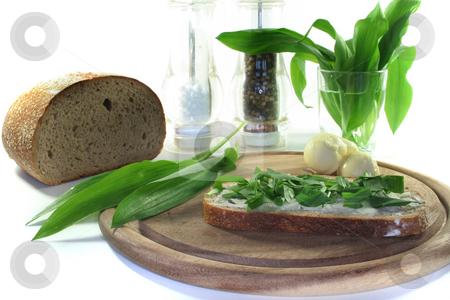 Wild Garlic Bread stock photo, A slice of buttered bread with freshly chopped wild garlic by Marén Wischnewski