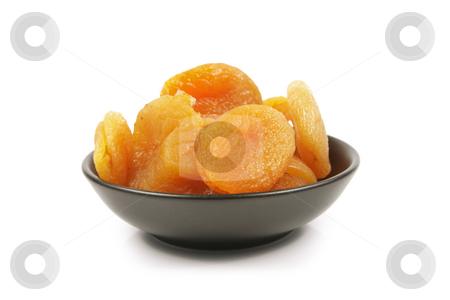 Dried Apricots in a Bowl stock photo, Dried juicy orange apricots in a small black bowl on a reflective white background by Keith Wilson