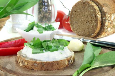 Cottage cheese bread with wild garlic stock photo, A slice of bread with cottage cheese and freshly chopped wild garlic by Marén Wischnewski