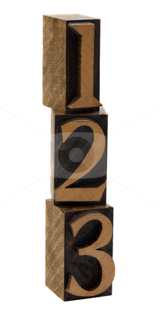 One, two, three wood numbers stock photo, 1, 2, 3 numbers in vintage wooden letterpress blocks, stained by black ink, stacked vertically, isolated on white by Marek Uliasz