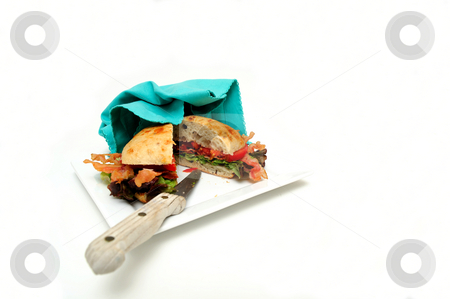 Isolated BLT Sandwich stock photo, Bacon lettuce and tomato sandwich also known as a BLT on a Ciabatta roll served on a plate by Lynn Bendickson