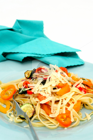 Fettucini stock photo, Fettuccine with vegetables sauteed in olive oil with sweet peppers, sliced zucchini squash with grated parmesan cheese by Lynn Bendickson