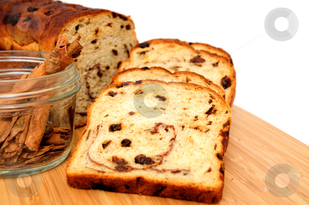 Raisin Bread And Cinnamon stock photo, Slices of raisin cinnamon bread with slices laid out showing the detail in the slice including the raisins by Lynn Bendickson