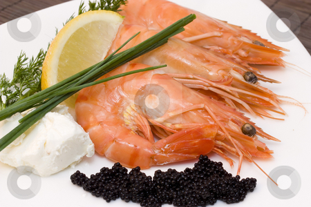 Shrimps and caviar stock photo, A plate with fresh caviar, chive and shrimps by Sabino Parente