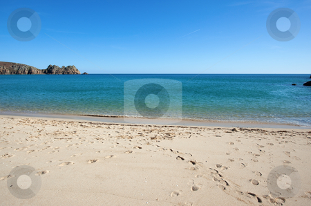 Porthcurno sandy beach and Logan rock in Cornwall UK. stock photo, Porthcurno sandy beach and Logan rock in Cornwall UK. by Stephen Rees