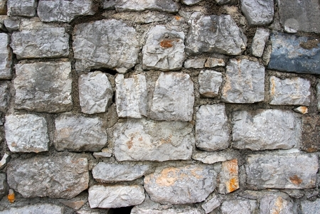 Wall stock photo, Grainy texture of an old gray stone wall by P?