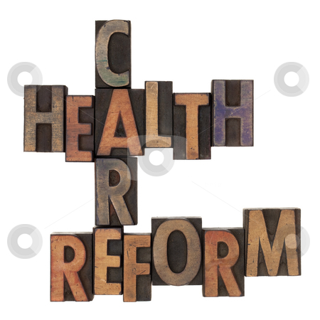 Health care reform crossword stock photo, Health care reform crossword in vintage wooden letterpress types stained in ink, isolated on white by Marek Uliasz