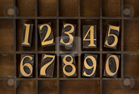 Wood numbers - vintage letterpress type stock photo, Ten arabic numerals from zero to nine, vintage wood letterpress blocks stained by black ink in old typesetter case with dividers, types flipped horizontally by Marek Uliasz