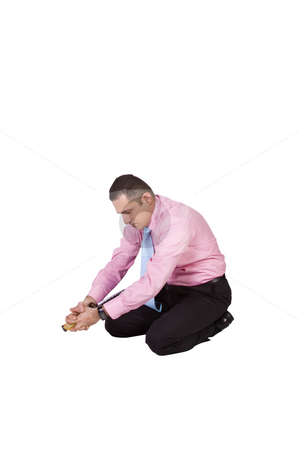 Businessman Committing Suicide with a Sword - Harakiri stock photo, Businessman Committing Suicide with a Sword - Harakiri on an Isolated Background by Mehmet Dilsiz