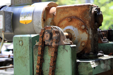 Old Farm Sorting  stock photo, Close-up of an old, rusted gear and chain on an electric motor outdoors by Carl Stewart