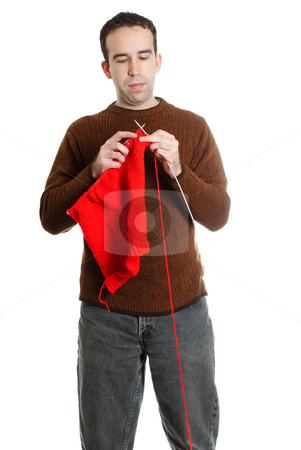 Knitting stock photo, A man knitting something, isolated against a white background by Richard Nelson