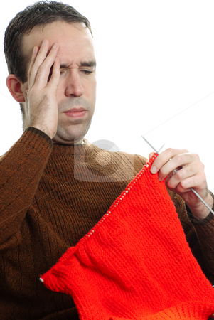 Hobby Frustration stock photo, A young man is getting frustrated at his knitting, isolated against a white background by Richard Nelson