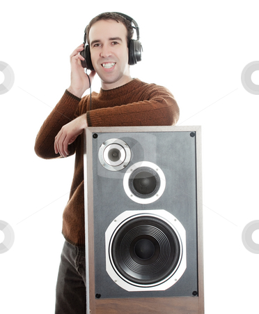 Man Listening To Music stock photo, A young man wearing headphones and leaning on a large speaker, isolated against a white background by Richard Nelson