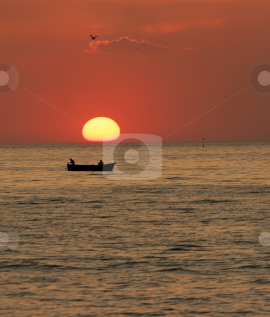 Sunset stock photo, Sunset at the sea with the silhouette of a boat and a bird by P?