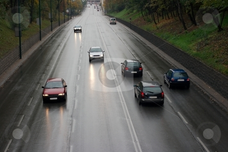 Traffic stock photo, Wet road with traffic passing by by P?