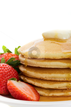 Golden pancakes stock photo, Fluffy golden pancakes with strawberries and maple syrup by Steve Mcsweeny