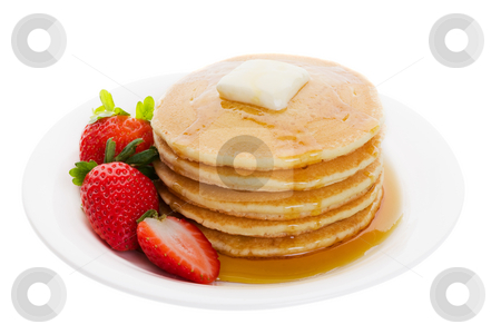 Plate of pancakes stock photo, Plate full of fluffy golden pancakes with strawberries and maple syrup by Steve Mcsweeny