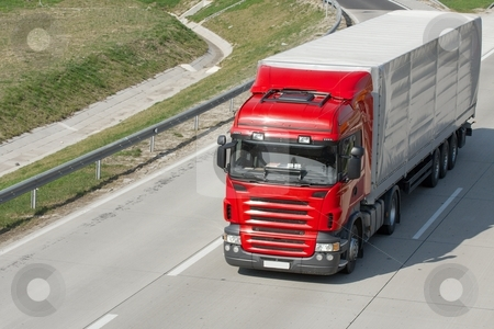 Truck stock photo, Red truck running on the highway by P?