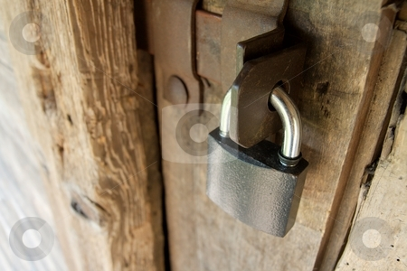 Locked stock photo, Padlock on an old wooden door by P?
