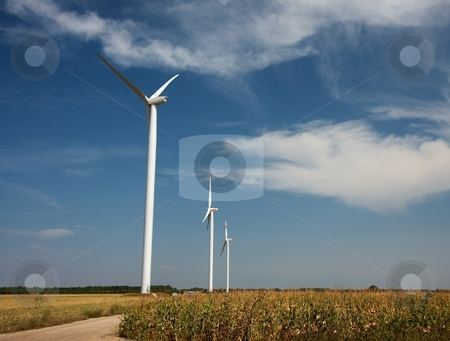 Wind power stock photo, Three wind power turbines on a field by P?