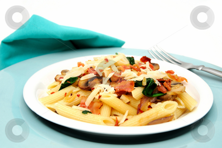 Penne Pasta stock photo, Penne pasta with saut?ed mushrooms garlic and Spinach with crumbled bacon and grated parmesan cheese severed on a turquoise and white plate combination. by Lynn Bendickson