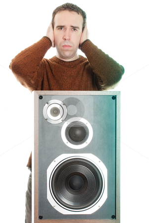 Loud Music stock photo, A young man covering his ears in pain, because of the loud music, isolated against a white background by Richard Nelson
