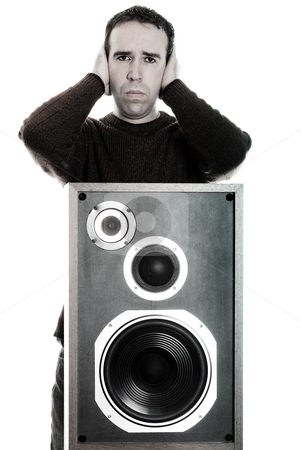 Migraine stock photo, A young man suffering from a migraine because of the loud music, isolated against a white background by Richard Nelson