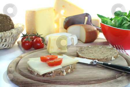 Cheese bread with tomato stock photo, A slice of bread with cheese and fresh tomato slices in a cheese assortment by Marén Wischnewski