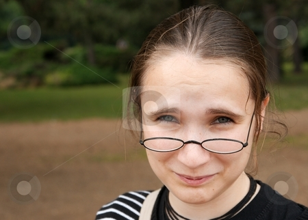 Girl stock photo, Girl with glasses looking confused by P?