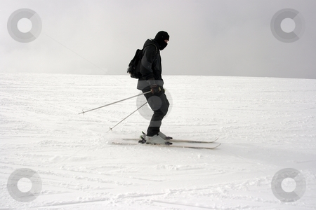 Skier stock photo, Skier sliding down the slope by P?
