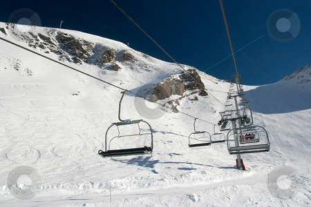 Lift stock photo, Ski lift going up to the mountain by P?