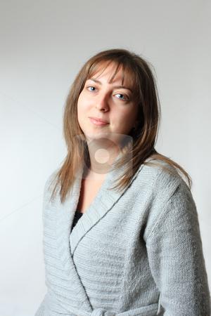 Portrait of a girl stock photo, Portrait of a cute happy girl on gray background by Nikola Spasenoski