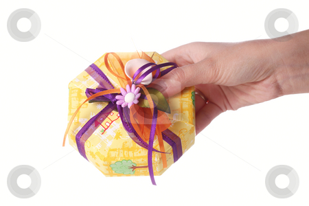 Hand giving a present stock photo, Hand giving a gift box isolated on white by Nikola Spasenoski