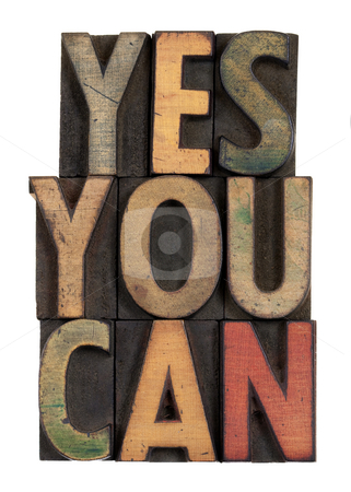 Yes you can - motivational slogan in wood type stock photo, Yes you can - motivational slogan in vintage letterpress wooden type, stained by ink, isolated on white by Marek Uliasz