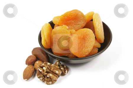 Dried Apricots and Nuts stock photo, Dried juicy orange apricots with mixed nuts in a small black bowl on a reflective white background by Keith Wilson