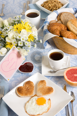 Heart shape toast stock photo, Mother's day table with eggs and heart shaped toast by Anneke
