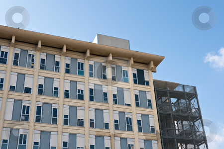 Hospital  stock photo, Exterior of a modern hospital complex under a blue sky by ANTONIO SCARPI