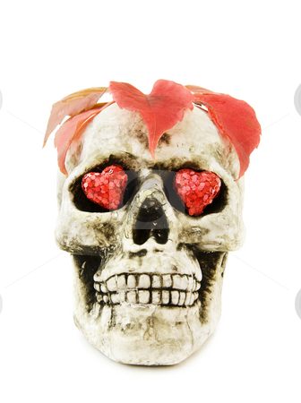 Love Halloween with skull stock photo, Celebrating Halloween with scary human skull decorated with red hearts and dead leaves. Isolated on white background. by Andreea Chiper