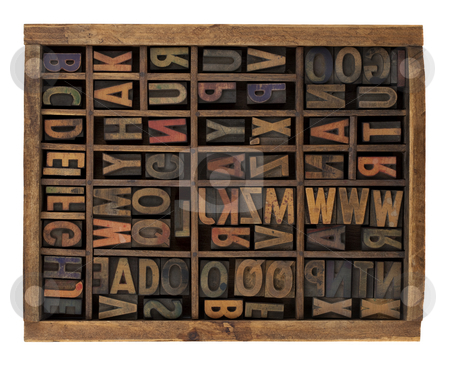 Alphabet in antique wood letterpress types stock photo, Vintage wood letterpress types, stained by ink, placed randomly in typesetter drawer, isolated on white by Marek Uliasz