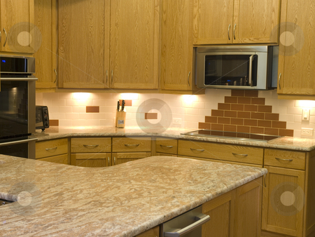 Modern kitchen stock photo, Photo image of a mopdern kitchen with granite countertops by P.J. Lalli