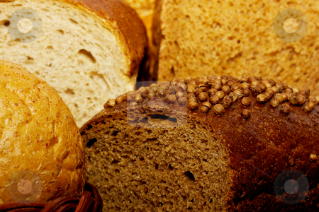 Assortment of baked bread stock photo, Assortment of baked bread by Andrey Starostin
