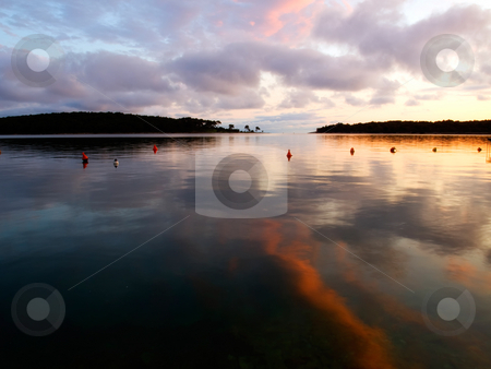 Painted calm stock photo, Reflection of clouds and sunset on the quiet surface of the sea. by Sinisa Botas