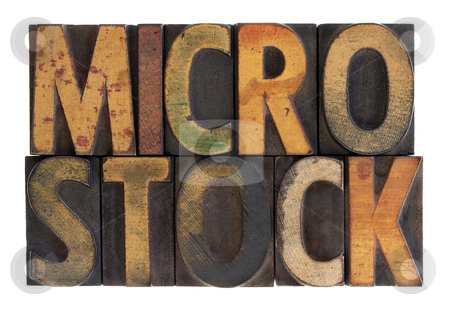 Microstock - vintage wood letterpress type stock photo, The word microstock in vintage wood block type, stained by color ink, isolated on white by Marek Uliasz