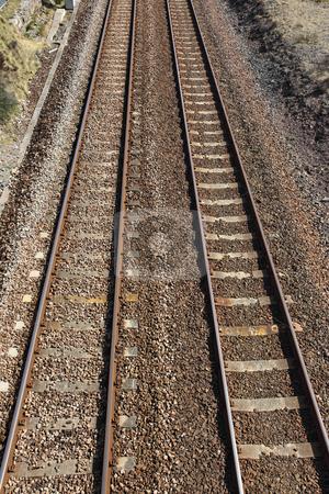 Two British railway line tracks. stock photo, Two British railway line tracks. by Stephen Rees