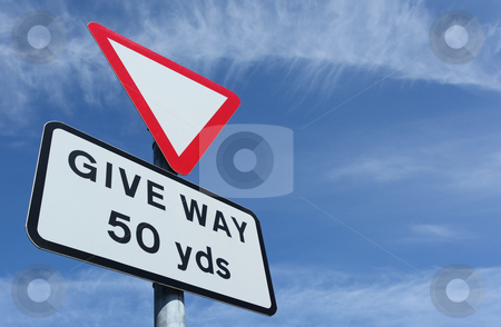 British give way in 50 yards road sign and a blue sky. stock photo, British give way in 50 yards road sign and a blue sky. by Stephen Rees