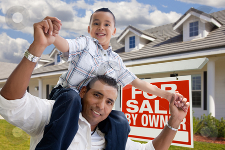 Hispanic Father and Son with For Sale By Owner Sign stock photo, Excited Hispanic Father and Son with For Sale By Owner Sign in Front of House. by Andy Dean