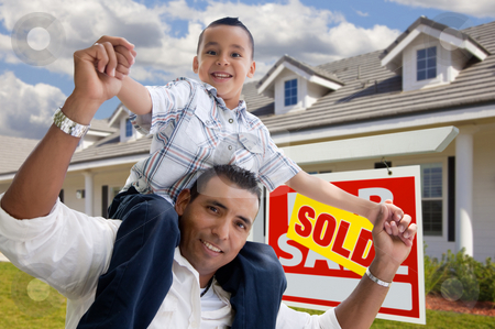 Hispanic Father and Son with Sold Real Estate Sign stock photo, Excited Hispanic Father and Son with Sold For Sale Real Estate Sign in Front of House. by Andy Dean