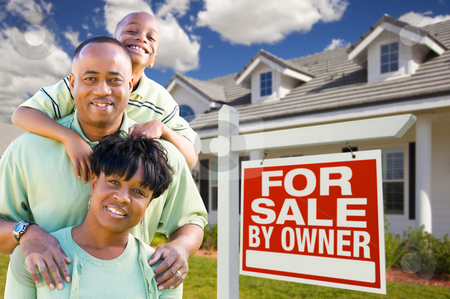 African American Family with For Sale By Owner Sign stock photo, Attractive, Happy African American Family with For Sale By Owner Sign in Front of House. by Andy Dean