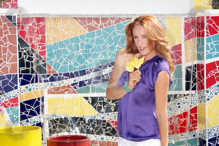 Beautiful Redhead with Mosaic Tiles (3) stock photo, A lovely young redhead stands in front of a mosaic tile waterfall that features a blank white rectangle in the top, which is ideal for displaying text, logos, links, etc. by Carl Stewart